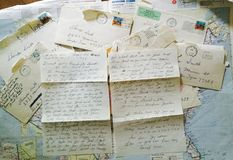 Old hand written letters. Some old written letter and envelopes from many years ago layer on a map of USA Royalty Free Stock Images