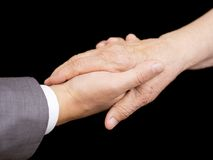 Old hand in young hand. Close up of old hand in young hand Royalty Free Stock Image