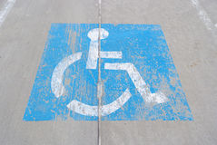 Old handicapped parking sign painted on concrete Stock Image