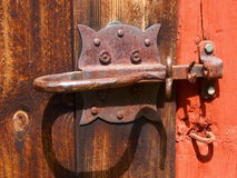 Old handle. A rusty handle of an old barn door Royalty Free Stock Images