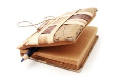 Old handmade notebook with blue pencil Royalty Free Stock Photo