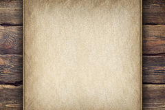Old handmade paper sheet on wooden background Stock Image