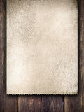 Old handmade paper sheet on wooden background Royalty Free Stock Photos