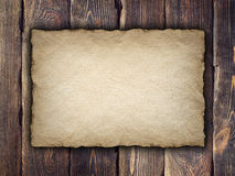 Old handmade paper sheet on wooden background Stock Photography