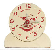 Old Handmade Wooden Toy Clock. Front view of an old handcrafted wood toy clock isolated on white with clipping path. Hand painted white with red numerals and a Stock Image
