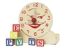 Old Handmade Wooden Toy Clock and Alphabet Blocks. An old handcrafted wood toy clock with alphabet blocks isolated on white with clipping path. Clock is hand Royalty Free Stock Image