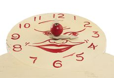 Old Handmade Wooden Toy Clock face. A low angle view of an old handcrafted wood toy clock face isolated on white with clipping path. Hand painted white with red Royalty Free Stock Images