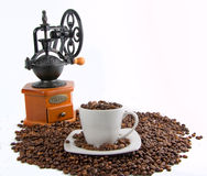 Old handmill with coffee bean Royalty Free Stock Photo