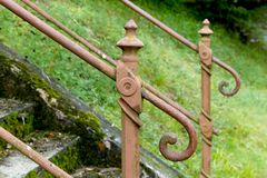 Old handrail on old staircase. Old handrail with forgotten and abandoned stairs royalty free stock photography