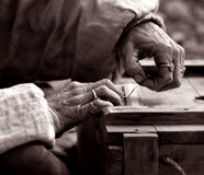 Old Hands. Creating American indian beading Stock Photo