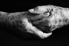 Old Hands. Hand of old woman in black and white Stock Image