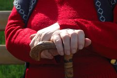 Old hands. Of woman red dressed Stock Image