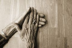 Old hands. On clean table stock images