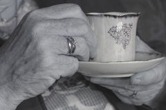 Old hands. With coffe cup Royalty Free Stock Image