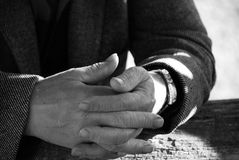 Old hands. A view with an old man with cross-hands Stock Photography