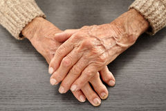 Old hands with artritis. Closeup of hands with artritis of an old farmer man stock photo