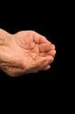 Old hands begging on the black Royalty Free Stock Images