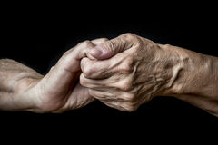 Old hands. On a black background stock image
