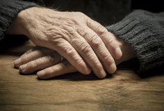 Old hands. Close up on a table royalty free stock image
