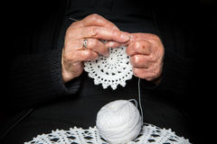 Old hands doing crochet Royalty Free Stock Images