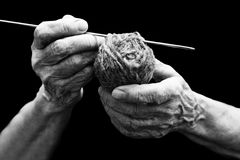 The old hands of grandmother and knitting Stock Images