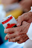 Old hands holding can Royalty Free Stock Image