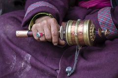 Old Hands Of A Tibetan Woman Holding Prayer Buddhist Wheel At A Hemis Monastery, Leh District, Ladakh, Jammu And Kashmir, North In Stock Images