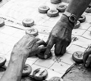 Old hands playing board game Stock Photos