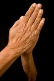 Old hands praying. An old asian woman holds her hands in prayer Stock Photos