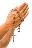 Old hands praying. An old asian woman holds her hands in prayer with a rosary stock photos