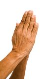 Old hands praying. An old asian woman holds her hands in prayer Royalty Free Stock Photos