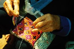 Old hands sewing. Old Thai woman working traditional costume Stock Photos