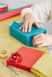 Old hands wrapping gift for Stock Image