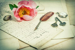 Old handwritings, antique feather pen, keys, pocket watch and pi Royalty Free Stock Photos