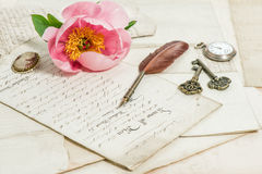 Old handwritings, antique feather pen, keys, pocket watch and pi Royalty Free Stock Images