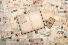 Old handwritten postcards and open empty book Stock Images