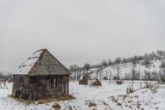 Old hangar in the snow stock photos