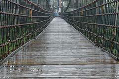 Old hanging bridge cross river in Shifen Taiwan. Old hanging bridge cross the river in Shifen Taiwan royalty free stock photos