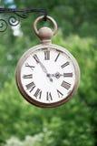 Old hanging clock Royalty Free Stock Image