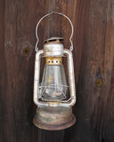 Old hanging kerosene lantern on wall. Stock Photo