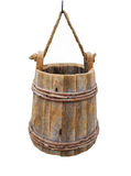 Old hanging wooden bucket isolated. Old wooden bucket hanging from a rope and hook.  Isolated on white Stock Images