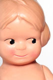 Old happy children doll portrait. Picture of a happy children/ baby doll Stock Photos