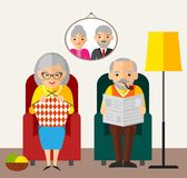 Old happy European man woman family sitting in an armchair at home. Stock Photography