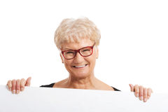 An old happy lady holding copy space. Stock Photos