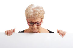 An old happy lady holding copy space. Stock Images