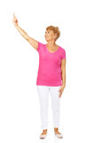 An old happy lady pointing for something Stock Image