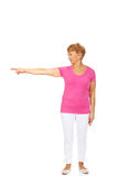 An old happy lady pointing for something.  Royalty Free Stock Photos