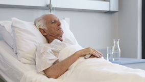 Old happy patient lying on bed stock video footage