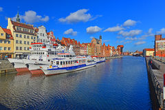 Old harbor canal with ships in Gdansk, Poland. Classic smaller passenger vessels moored in the Old Town in Gdansk, northern Poland. January view in good sunny Royalty Free Stock Image