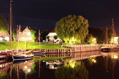 Old harbor of carolinensiel at night Stock Image